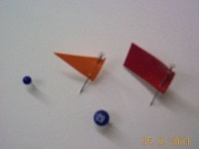 colored pins, pennants, flags, and numbered pins. Here's a fun parlour game...see if you can guess which is which!!!